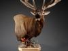 Forward Elk Carved Pedestal