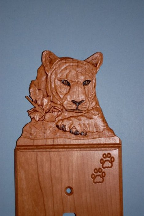 Close up of Carved Cougar Light Switch Cover