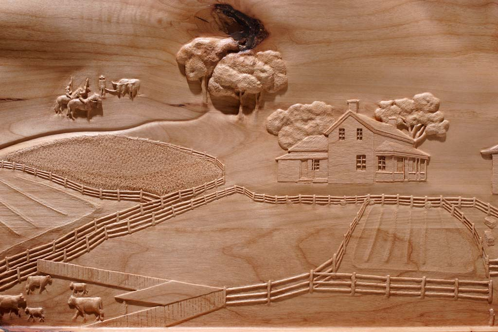 Fayette History carving of farms
