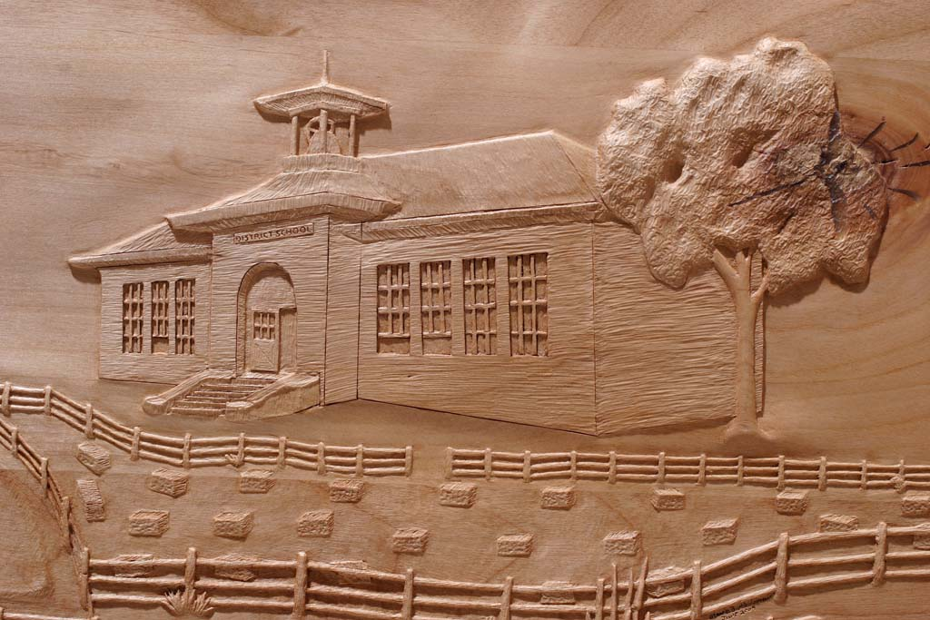 Fayette History carving of School House