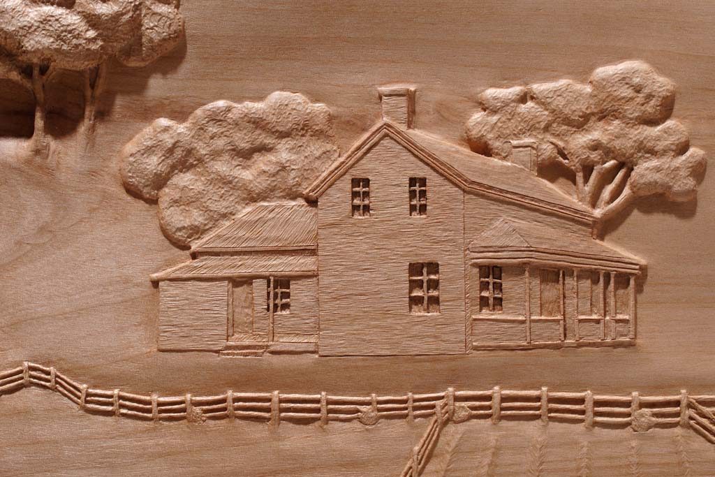 Fayette History carving of Original Home