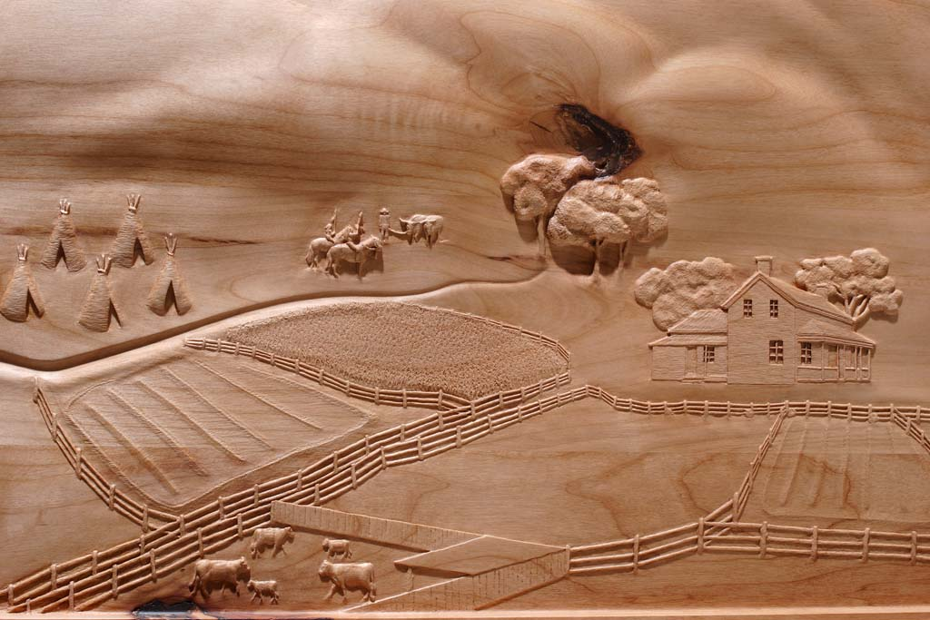 Fayette History carving of Mountains